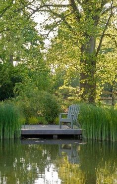 Wish I had a deck like this on our pond.