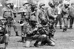 U.S. National Guardsmen firing a tear gas barrage into a crowd of demonstrators at Kent State University, Kent, Ohio, May 4, 1970.