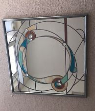 Image result for stain glass mirrors with art deco figures