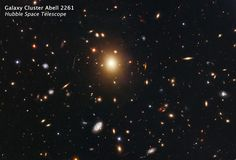The giant elliptical galaxy in the center of this Hubble image is the most massive and brightest member of the galaxy cluster Abell 2261. Spanning a little more than one million light-years,the galaxy is about 10 times the diameter of our Milky Way galaxy.