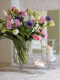 Flores y velas, linda y romántica combinación