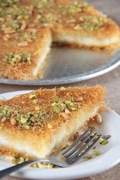 Photo about Knafeh (Arabic Sweets) in plate with fork - close up shot. Image of baker, ingredients, sugar - 15409244 Greek Sweets, Greek Desserts, Greek Recipes, Arabic Dessert, Arabic Sweets, Kunafa Recipe, My Favorite Food, Favorite Recipes, Low Carb Brasil