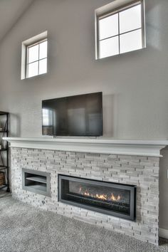linear fireplace with ledgerstone