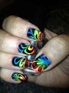 Psychedelic rainbow water marble nails