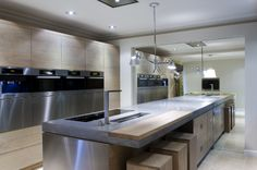 Cast concrete counter top with wood detail.