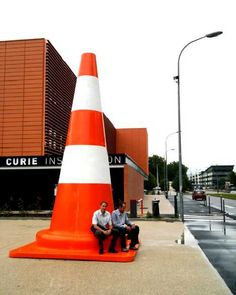 "Lilian Bourgeat likes to scale up everyday objects and what could be more ""everyday"" than the humble orange traffic cone? ""Le cône de chantier"" (The Cone Construction) sat around the campus of the INSA de Lyon, Frances foremost school of engineering, in the summer of 2010."