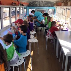 We've converted an old school bus into an  art studio for kids! We'll park the bus at your location