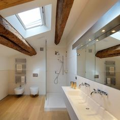 Great skylight and use of old beams in a modern setting  Private Penthouse by Menzo Architettura