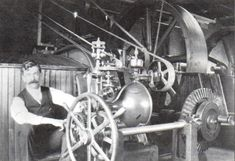 Elmer E. Woodward adjusting his  compensating-type mechanical water wheel governor in the 1920's.