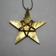 Textured Brass Star Pendant Wrapped with Light Brass Colored Wire on Etsy, $25.00