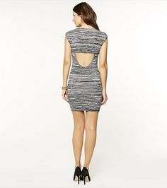 You'll certainly turn heads with this cut out back body con dress!- Want!