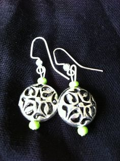 Earrings with antiqued silver beads and green seed beads with sterling silver earwigs