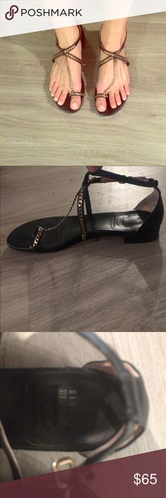Stuart Weitzman sandals Size 6 black sandals with gold chain toe ring. Leather soles! They have mild to moderate wear to sole only- other than that, they look really good on! Still have a lot of life left because they are so well made! Make an offer :) Stuart Weitzman Shoes Sandals