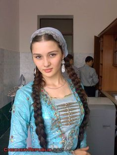 Girl from Chechnya wearing traditional costume  South western Russia