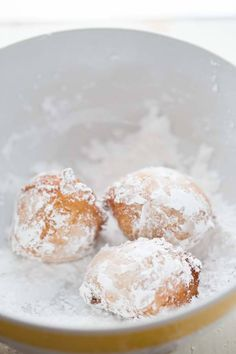 Italian style ricotta donuts are better than any store bought donut!  They are fluffy and light and served with two very easy dipping sauces! lemonsforlulu.com