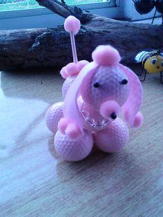 Pink poodle  golf balls