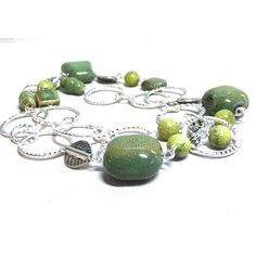 Green Beaded Necklace long natural stone necklace ceramic bead... ($45) ❤ liked on Polyvore featuring jewelry, necklaces, bohemian statement necklace, long boho necklace, green jade necklace, green beads necklace and beaded necklaces