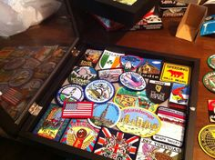 Patches are cheap souvenirs! Put them in a shadowbox for a cool display on the wall