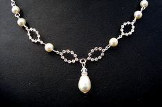 Pearl Necklace,Bridal Rhinestone Necklace,Rhinestone Necklace,Ivory Swarovski Pearl, Pearl Rhinestone Necklace,Wedding Pearl Necklace,STELLA. $38.00, via Etsy.