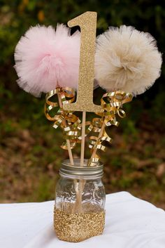 ***Please note that current processing time is up to 2 weeks plus shipping time. If you need an item sooner please message me BEFORE placing the order.***    This listing is for a custom pink and gold centerpiece. You choose number. You will receive: 1 number stick made from glittery card stock 1 pink pom pom stick and 1 gold pom pom stick 1 Gold glittery mason jar (1 pint sized jar)  The numbers measure approximately 6.5 inches tall without stick and 15 inches tall with stick. Pom poms are…