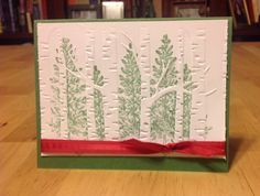Woodland embossing folder stamped in Garden Green ink with Lovely as a Tree. 2015 Stampin Up Holiday mini