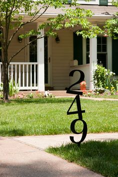 Creative display for your house number with this stacked numbers design