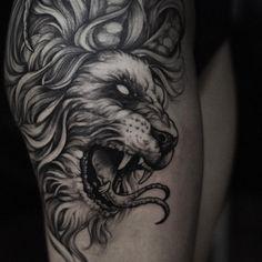 Amazing blackwork lion tattoo on thigh by @sashakatuna