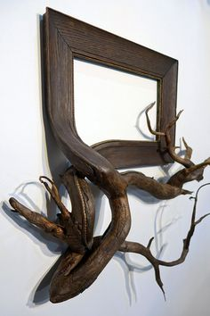 """To create his unique artworks Darryl Cox combines ornate vintage picture frames with real tree branches found in the forests of central Oregon, in the United States. """"The branches serve as a simple reminder of the materials used to build picture frames, but also create an unusual form factor where clean lines and ornate moulding patterns seem to naturally traverse the bark of each tree limb. Each piece involves many hours of woodworking, sculpting, and painting."""" More art on the g..."""