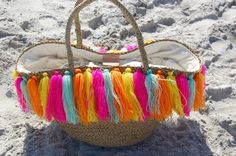 """The perfect beach bag with a drawstring lining inside- to protect your goodies from the sand! Approx. Measurements: 11""""H x 20""""W x 9""""D"""