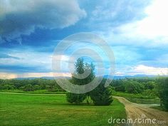 A painterly image of a dramatic thunderstorm rolling through the champlain valley of central Vermont. A rural scene of a small dirt road with fence and trees and mountains in the distance Photo Blue, Green Mountain, Thunderstorms, Vermont, Fence, Distance, Trees, Stock Photos, Mountains