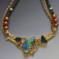 """""""Into the Deep"""" Boulder opal necklace on spinal & black diamond beads with drusy quartz, diamonds, sapphires & topaz in 22k and 18k gold. by Jennifer Kalled; Boulder Opal; Bill Kasso, Eagle Creek Opal"""
