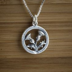 Double Sided Scottish Thistle Charm  by LittleDevilDesigns on Etsy, $14.00