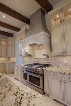 I like the lattice in glass doors, glazed cabinets, tile backsplash & range.  I do not like countertops though