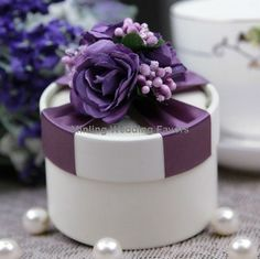 Gift boxes with purple satin ribbon and bow with lavender silk violets for a topper!!!