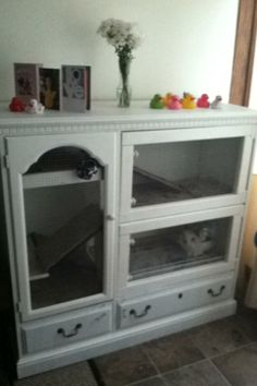 Bunny cage. Daisy's 3 story town house. // I really need to go thrifting and make something like this!!