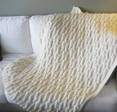 Free knitting pattern for Chunky Aran Cable Blanket and more cable afghan knitting patterns