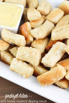 Pretzel Bites dunked in an EASY honey mustard dipping sauce...perfect for noshing after school or while watching a football game!