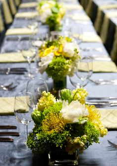 Low and a splash of colour.  #Floral #centerpieces #Decor #Wedding Find the best Toronto and the GTA have to offer on thePWG.ca http://www.theperfectweddingguide.com/wedding_florist.html http://www.theperfectweddingguide.com/wedding_decor.html