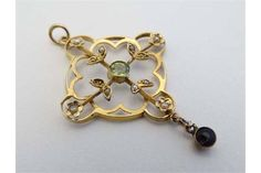 """Suffragette Jewellery : A yellow metal pendant set with peridot, amethyst and seed pearls. Approx 1 1/4"""" long  Estimate: 150 GBP - 180 GBP"""
