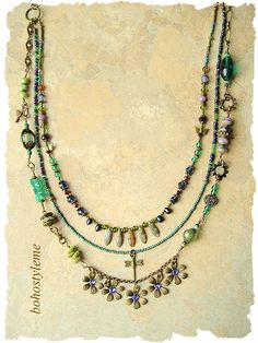 This vintage style art necklace is created with three unique layers. Clusters of vintage glass, glass flowers, freshwater pearls, crystals and a wonderful assortment Czech glass beads, are wired together creating a beaded chain. Five vintage brass flowers, adorned with purple Swarovski
