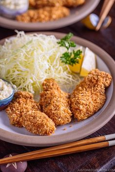 Japanese Fried Oysters (Kaki Fry) served with tartar sauce and shredded cabbage on the white plate.
