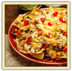 Fajita Chicken Nacho Supreme ~   Tortilla chips covered with fajita chicken, cheese, jalapeño peppers, onions, and tomatoes; with sour cream and guacamole on the side.