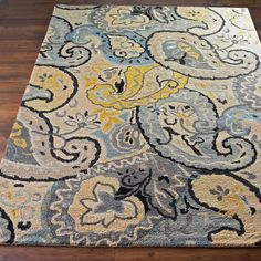 Butter and Steel Paisley on Cream A stylized paisley pattern is given new life in fresh shades of steel blue, silver, butter yellow, gray and black. This over scaled design makes a bold statement while keeping the colors more subdued. Hand hooked in India of 100% wool in soft knobby loops for great texture underfoot