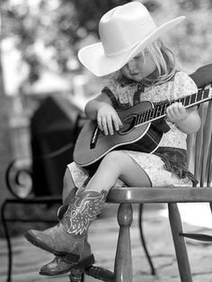 Baby Cowgirl with her guitar <3