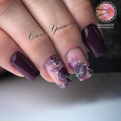 Beautiful burgundy nail.polish and decadent flower design
