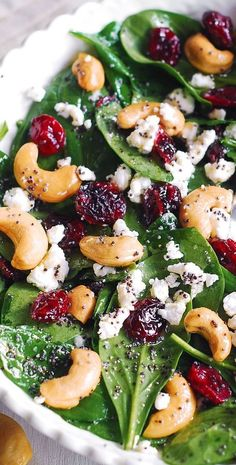Cranberry Spinach Salad with Cashews and Goat Cheese and Lemon-Honey Poppy Seed Dressing. Delicious, healthy salad with easy ingredients. I love spinach salad and make it all the time using different kinds of ingredients. Cranberry Spinach Salad, Spinach Salad Recipes, Cranberry Cheese, Healthy Salad Recipes, Vegetarian Recipes, Cooking Recipes, Spinach Salad With Cranberries, Dried Cranberries, Beet Salad