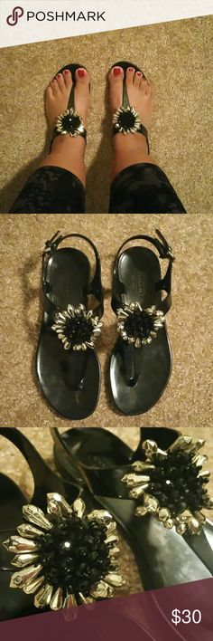 "Coach black jelly floral sandals Worn a few times  Size is 5  Black with silver  The hardware around the ankle is a bit tarnished and the black on the straps is not that shiny.   Sorry no trades  If you don't like the price please use the offer button.  If you have any questions please ask.   Have an amazing day!   ""Great Sense of Style"" Coach Shoes Sandals"