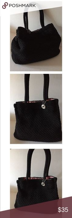 The SAK Black Crochet Knit Shoulder Bag THE SAK BLACK KNIT BAG WITH PINK LINING HANDBAG,     MEASURES 12'' ACROSS TOP, 10'' HIGH. 6'', 7'' CLEARANCE STRAP HANDLE,  6'' INNER ZIPPERED POCKET, 2 OPEN SLOTS AND A MIDDLE PEN SLOT,   Preowned in good condition The Sak Bags Shoulder Bags