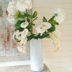 Huge flowers in a white Summer lodge