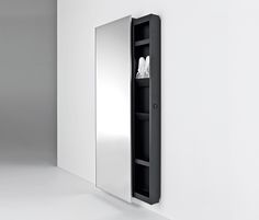 Mirror design evolves and integrates with new features. A fixed and safe mirror hides a metal storage container that slides left or right to reveal its..
